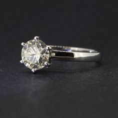 Pre-Owned 14ct White Gold Diamond Solitaire Ring. This Is A Beautiful Ring With A Slight Pale Yellow Tint, Which Give The Stone A Soft Hue. Supplied With A Certificated Valuation. Estimated Diamond Weight 1.20 Carat. Estimated Diamond Clarity I2.