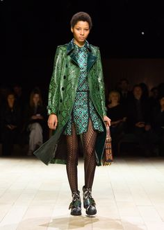 Stone-buffed bright green trench coat with heritage details, worn with a deep green metallic jacquard shirt dress, The Buckle Boot in geometric print and The Patchwork bag. Discover the collection at Burberry.com