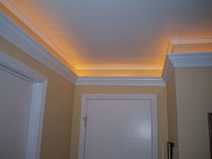 Leave some space from ceiling, use crown moulding and put lights on top.