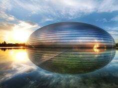 """National Center for the Performing Arts, Beijing, China. This half oval dome reflects on a body of water, creating an egg shaped image, which is where it got its """"The Egg"""" nickname."""