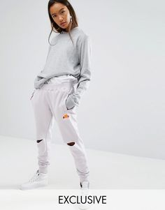 Buy it now. Ellesse Relaxed Joggers With Knee Rips - Purple. Joggers by Ellesse, Soft-touch sweat, Stretch waistband, Side pockets, Signature logo, Ripped knees, Fitted cuffs, Relaxed fit, Machine wash, 100% Cotton, Our model wears a UK 8/EU 36/US 4 and is 170cm/5'7 tall, Exclusive to ASOS. ABOUT ELLESSE Remember the '90s when you weren't anyone if you didn't own an Ellesse sweatshirt? Well, streetwear fans take note because we've come full circle and the Italian brand is back in a big way…