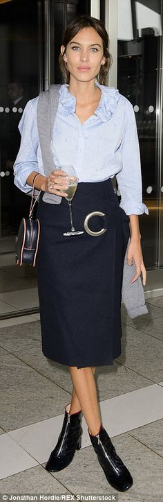 Business chic: Alexa, 31, was rocking a smart pencil skirt and a blue blouse with ruffle d...