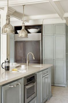 cabinet color/ for either cabinets or walls by Sherwin Williams: Trim – Shoji White SW7042 Island Cabinet (grey/blue) – Chatroom SW6171 with glazing finish Perimeter Cabinets (grey/cream) – Wool Skein SW6148 with glazing finish Wall – Wool Skein SW6148