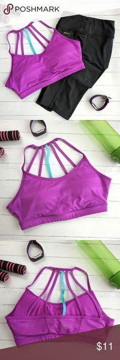 MPG Purple Strappy Sports Bra MPG Strappy Sports Bra Bright purple lilac color with fun strappy back detail. Size Medium but fits like a large.  Did not come with pads but I have added some. Can be removed.  Great condition! MPG Intimates & Sleepwear Bras