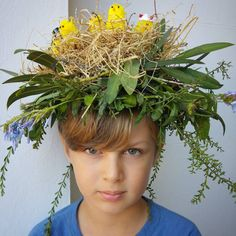 Boys or Girls Easter Bonnet Ideas 2017. Made from natural products using green foliage, flowers, twigs and dry weeds. All spun together to create a birds nest bonnet. Little chicks added to the top of the nest to complete the final touch.
