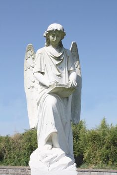 "Natchez City Cemetery - ""The Turning Angel"" - so named because at night when cars drive by on Cemetery Road their headlights shine upon the monument and to some it appears to turn as their car passes by."
