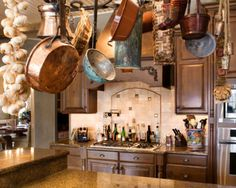 Love the look of the dark wood and tile. Also I love the hanging pots!