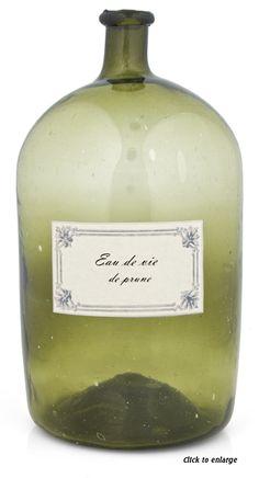 Antique French Eau de Vie bottle. Mouth-blown green glass with  Eau de Vie de Prune label -1905