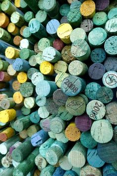 Dyed wine corks - would look nice as a filler in a clear vase