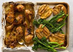 Overhead photo of Honey Mustard Baked Chicken Drumsticks with Smashed Potatoes on a silver tray with a side of steamed broccolini