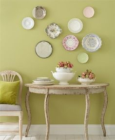 the totally unkempt placement of the plates is delicious as is the table and chair and wall color!