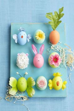Craft your own herd of Easter characters by adhering faux flower petals, buds and leaves to colored eggs. (Paint and decorate ceramic eggs and you can display this craft every spring!);Paint ceramic eggs and let dry completely