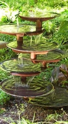 This water feature would be nice tucked away in the garden along a path with maybe a bench next to it. I played off the idea of overlapping circles and love the bronze color, going with the color scheme.