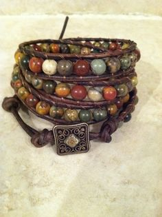 Multi-colored picasso Jasper quadruple leather wrap bracelet.