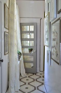 Segreto Secrets: consider adding mirrors inside the recessed panels. This small inclusion looks so charming and reflects any existing light which would do wonders to brighten up a dark hall or entryway!