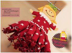 """Adventskalender """"Prinzessin Emilia"""" (Nähanleitung und Schnittmuster) von doityourself.shesmile.de  An der Schlaufe am Kopf der Prinzessin kann der Kalender ganz einfach an einem Nagel an der Wand, besser aber an der Vorhangstange im Kinderzimmer, an einem Türgriff, Schranktürgriff oder an einem Blumenhaken an der Decke aufgehängt werden. Der Adventskalender ist gleichzeitig eine stimmungsvolle Weihnachtsdekoration."""