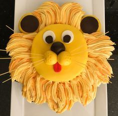 This lion cake will be the hit at your kid's next birthday party. The simple pull-apart cupcake design is an easy and fun way to serve this 'roaring' cake!                                                                                                                                                                                 More