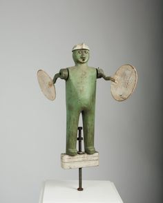 AMERICAN FOLK ART CARVED AND PAINTED WHIRLIGIG OF A MAN.