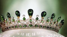 One of Queen Victoria's tiaras made with white diamonds and cabochon emeralds. It was designed by her husband Prince Albert. What a man!