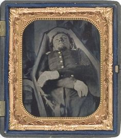 post mortem ambrotype portait of a Union officer in his coffin- a fallen hero. Staged images of the dead were not uncommon during the Civil War. Learn more: DEATH AND THE CIVIL WAR Thursday, Oct 3 at American Civil War, American History, British History, Post Mortem Pictures, Post Mortem Photography, Momento Mori, Civil War Photos, Asian History, Macabre
