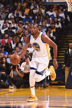 Kevin Durant of the Golden State Warriors handles the ball against the Los Angeles Lakers on April 12 2017 at ORACLE Arena in Oakland California NOTE...