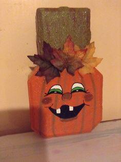 I painted a happy Jack-o-lantern on a keyhole paver