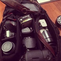 """""""What's in my camera bag """" Photography Gear Essentials by George Ganio of Melbourne, Australia. Featuring a Lux Brown Kawa Pro Strap .... suweeet!"""