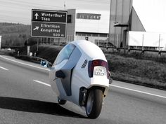 The Peraves Monotracer is a 2 wheeler that aims to combine the safety of a car with the flexibility of a motorbike.   And no it's not a prototype, it is a production vehicle, the asking price is a hefty 52.500 EUR though.