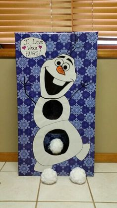 Olaf game...throw the ball in the holes. Great for kids school christmas party game. I got the light up balls..that light up when thrown. Added an access panel in the bottom back.