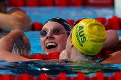 Missy Franklin of the USA (L) is congratulated by Emily Seebohm of Australia after the Swimming Women's 100m Backstroke Final on day eleven of the 15th FINA World Championships at Palau Sant Jordi on July 30, 2013 in Barcelona, Spain.