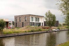 Baksteen en stucwerk gevel | architectuur | JADE architecten