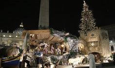 Pope Francis prays in front of a nativity scene in St Peter's Square