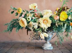 Yellow and greenery centerpiece | Photography: Heather Hawkins