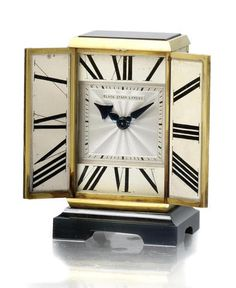 An art deco gold, onyx, enamel and diamond travelling clock, by Black, Starr & Frost, circa 1925.