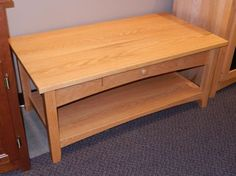 "Amish built coffee table crafted from Oak finished in a light, golden stain.  It features a solid, fixed shelf at the bottom and a sing, dove-tailed drawer.  Dimensions:  42"" W x 22"" D x ""18 H  (One currently available)  **Two matching end tables are also in stock."