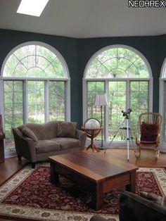 Dream all-season's room... LOVE the arched windows...