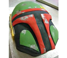 One of our brides surprised her groom with this custom Boba Fett cake we created.