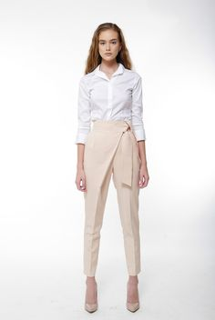 Our fine selection of classy statement trousers offers a wide range of pairing opportunities as required or desired. This high waist pant features a side tie pencil pant that can be paired with sleeveless blouses or a button up top. Regardless of how you choose to wear it, this pant is designed to give you that luxe chic summer look you desire. Pair with the Parker Suit Blazer to complete your look.