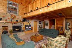 "Great Bear cabin in Gatlinburg - Great Bear is a 3 story, 6 BR with an additional loft BR, and 6 1/2 BA cabin. The living area has a gas fireplace, 50"" HDTV with DVD/VCR combo, 2 leather sofas, 2 recliners and a wet bar with sink and mini fridge. There's a laundry room w/ full size washer/dryer and a separate half bath off the living room. The dining area will seat 14 comfortably, and there are also 4 bar stools for extra seating."