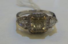Unique. Like the shape and yellow diamond. Fancy Yellow Engagement Ring 2.10ct