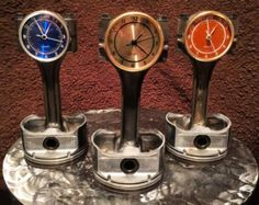These are piston clocks made from recycled Chevy Pistons from 350 (5.7L) engines. they are from different eras and may have a slightly different look from piston to piston (some have riser tabs on the sides of the piston/base). They are sandblasted or hand cleaned (clear only), powder coated, and a clock insert is added. One of these clocks will look great in your office, garage, or man-cave! Please feel free to ask any questions about colors or size. The first photo has orange, green…