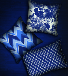Not sure why but I love the cushion with the diamond cross-cross pattern. Florence Broadhurst