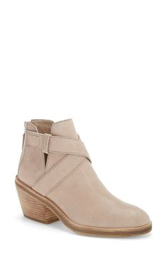 Subtle cutouts and crisscrossed straps lend modern style to this low-profile almond-toe bootie shaped from lightly pebbled leather.