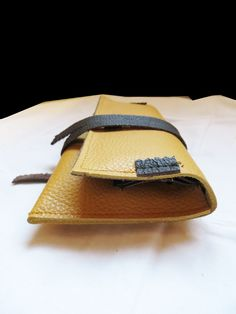 yellow and brown tobacco pouch leather