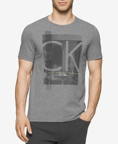 For a picture-perfect casual look, reach for this Calvin Klein graphic-print T-shirt, featuring a crew neck and soft, cotton construction. | Cotton | Machine washable | Imported | Crew neck | Short sl