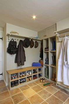 Here you can see the bespoke boot, shoe and coat storage area.