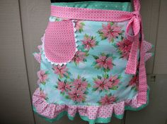 I love this pink poinsettia apron. I'm not particularly girly but I do like pink. This one is sweet. And a nice departure from the same ol' red and green at Christmas.