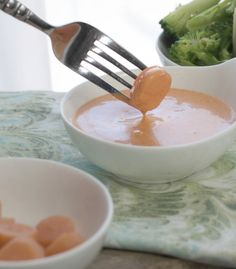 Japanese white sauce with a carrot disk being dipped in for the post Japanese White Sauce