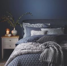 Love the blue bedding with maybe a darkish grey wall and white distressed headboard.