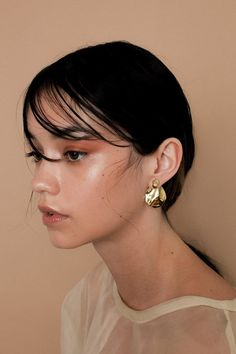 """Pearl-shaped ear stud and organic rounded ear jacket from LLY. Mirror finish gold-plate. Jacket and stud: gold-plated brass. Post and backings: gold-plated silver. - Allergen free - High polish - Appox. 1.25"""" long"""
